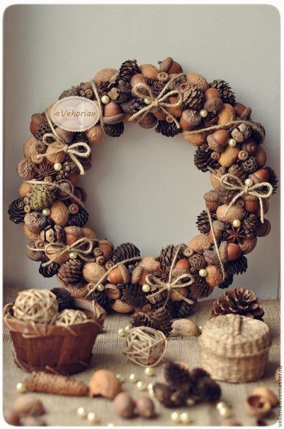 Wreath made with nuts, pine cone, seed pod, and star anise
