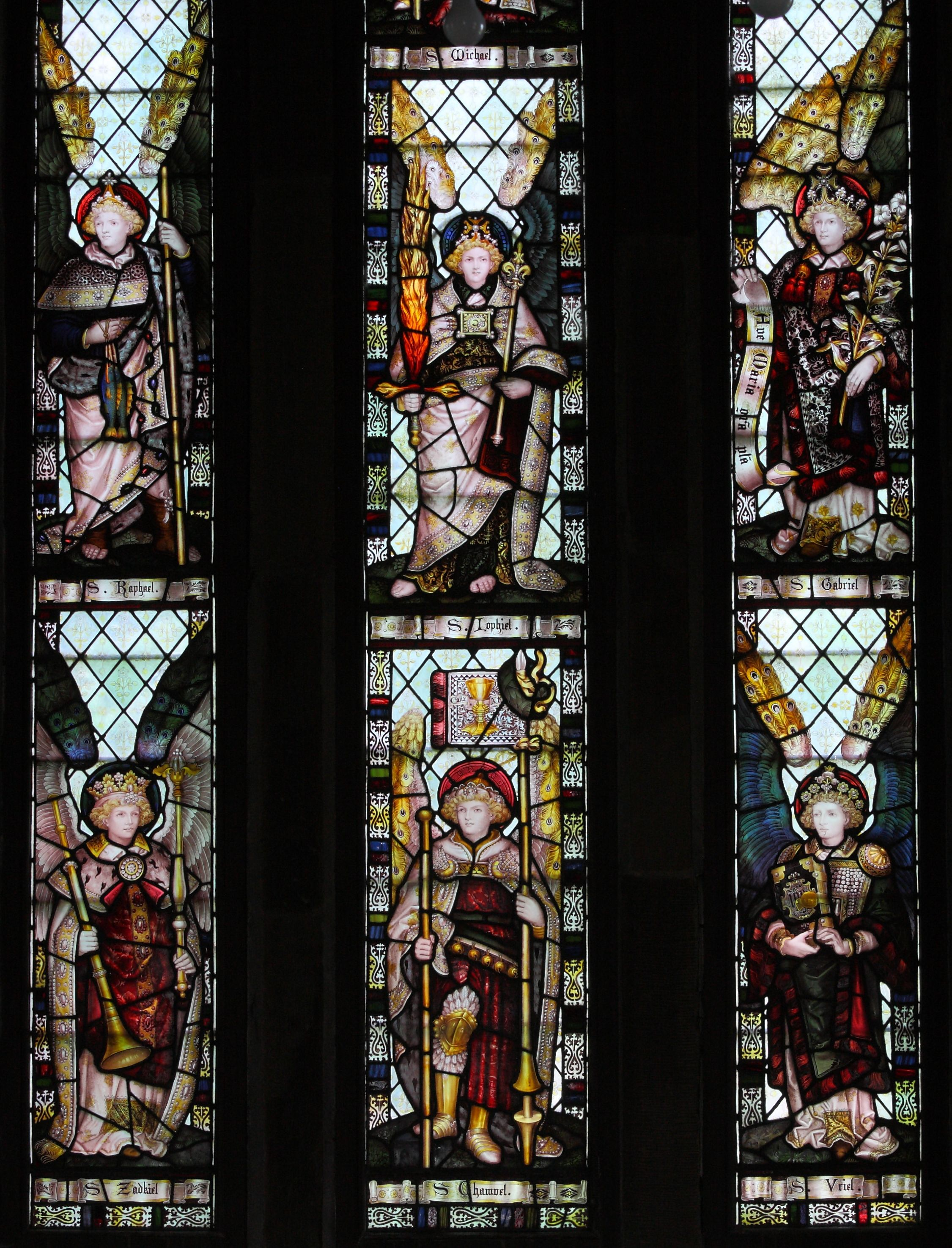 North transept window by CE Kempe 1891 showing the seven archangels Michael, Uriel, Gabriel, Iophiel, Raphael, Zadkiel, Chamuel - six of them shown here, Michael is at the top but a hanging light is in the way   https://farm5.staticflickr.com/4141/4781325020_0a5a42e880_o.jpg