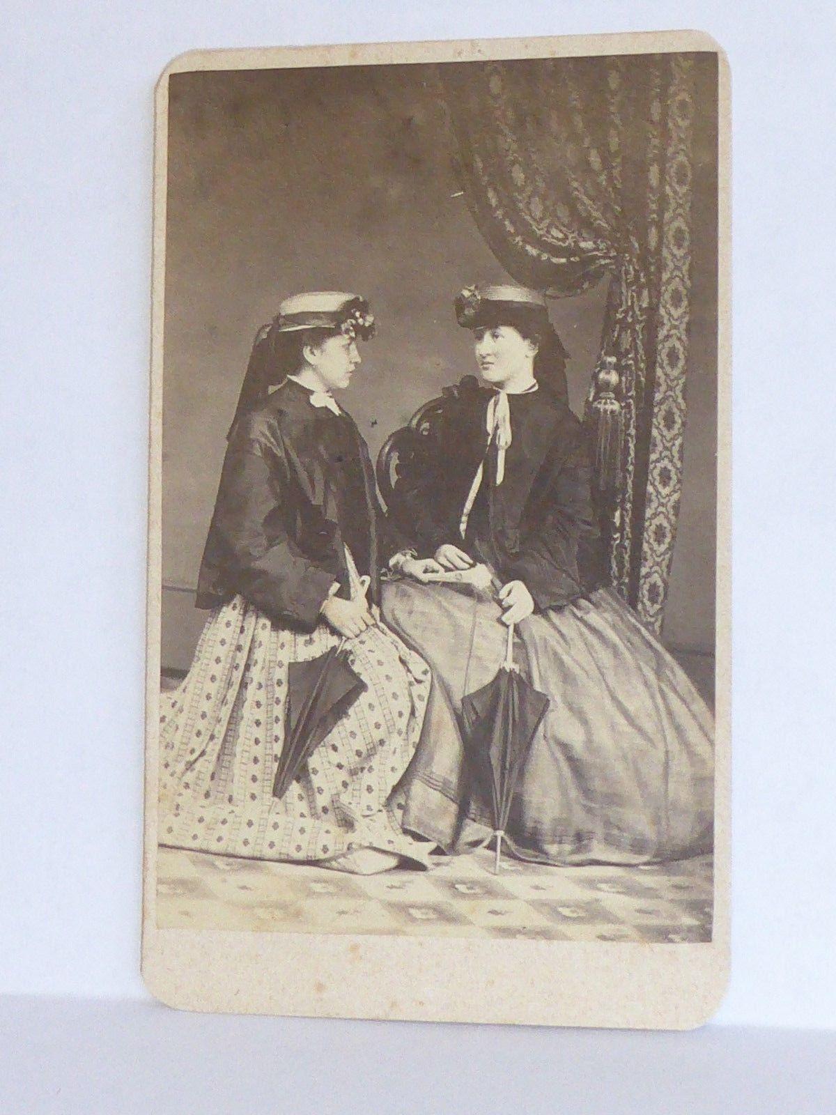 CDV, 1860's, two young woman, jackets, parasols, fan, hats.