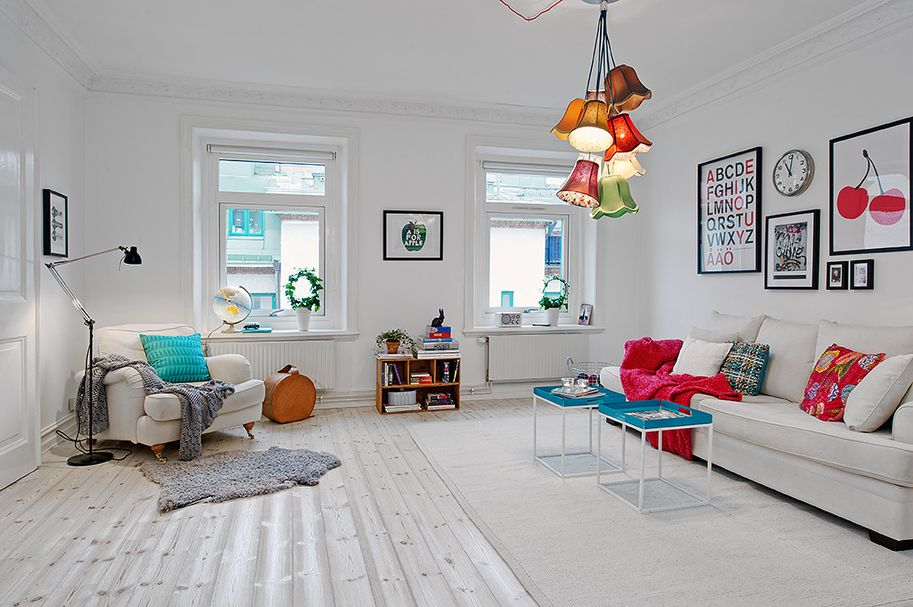 I've fallen for this quirky yet cosy Stockholm apartment! Especially that cluster of lamp shade lights!