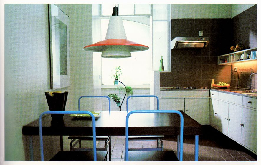 red/white space age po-mo lamp, blue metal backed chairs, black lacquer table, 1984