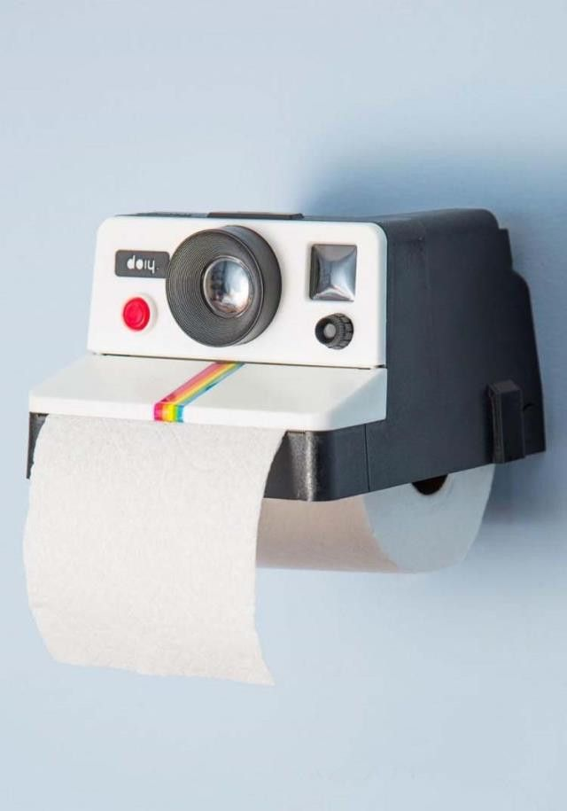 Say Cheese! Whilst we don't advise that you have cameras in bathrooms, you are safe with this retro polaroid camera style holder. Dispensing paper just like photos we do not recommend shaking this one
