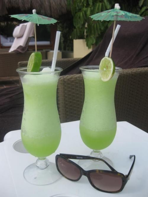 Make it at Home: Electric Lemonade  1 oz Midori, 1 oz vodka, 2 oz sour mix or margarita mix  Will be drinking there soon :)