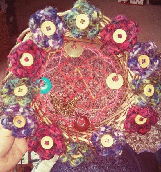 Crocheted flowers make a nice border for my pentagram weave
