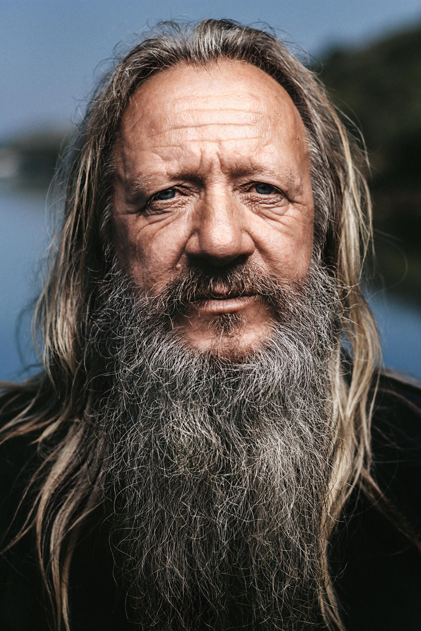 Portrait Of An Old Fishermen With Long Hair And White