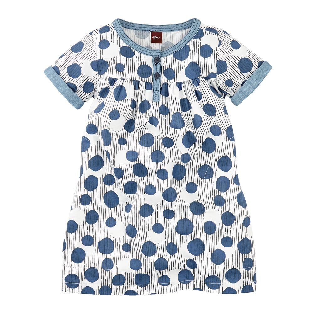 With a funky pattern & light cotton, this dotted little girls dress is great for any event. Dress up with a sweater or down with leggings from Tea Collection.