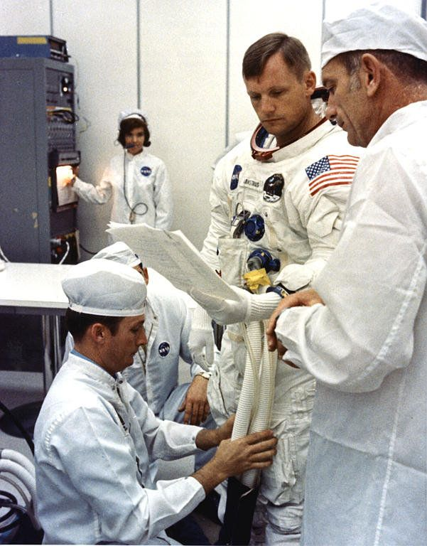 Apollo 11 astronaut Neil Armstrong looks over flight plans at NASA Kennedy Space Center in 1969.