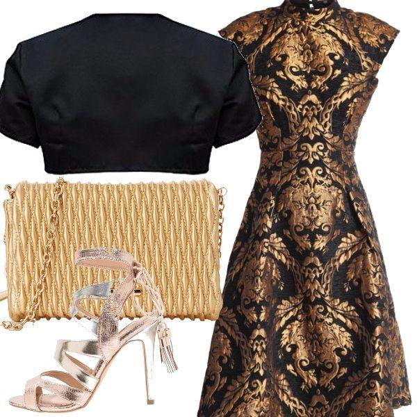 Vestito color oro e nero