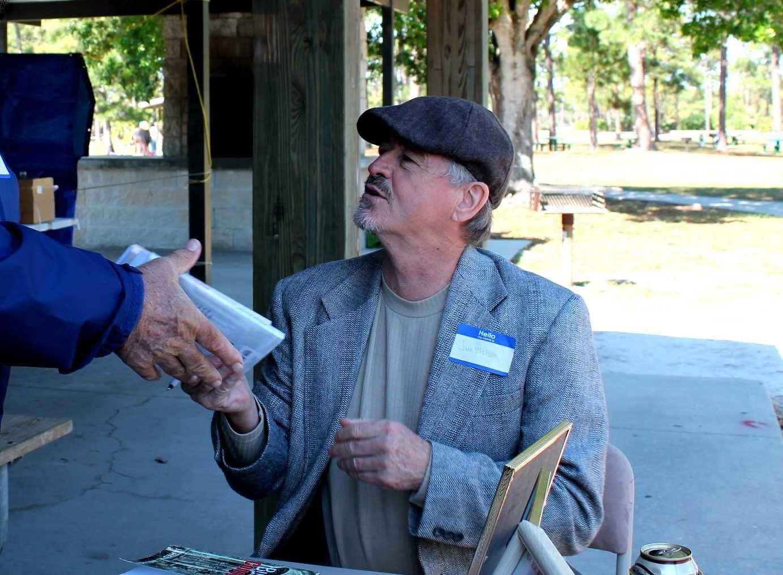 Signing books at the 27th Upper Peninsula picnic at