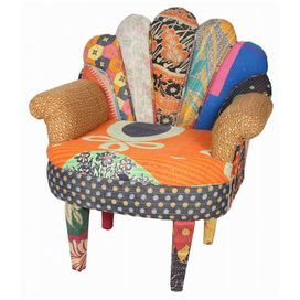 Bold peacock-style arm chair with vintage kantha patchwork upholstery.  Product: Arm chairConstruction Material: Vintage Kantha fabric and mango woodColor: MultiDimensions: 33 H x 29 W x 20 DCleaning and Care: Spot clean