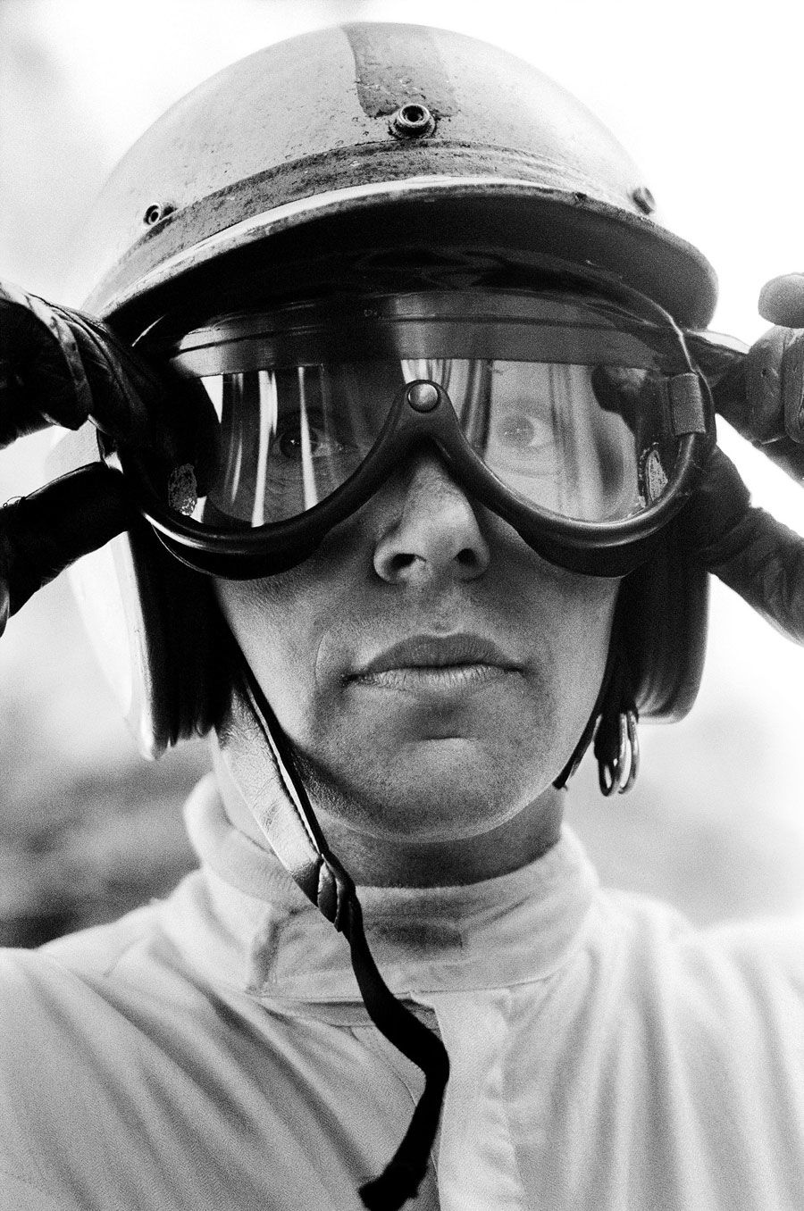 John Surtees. In all of history it has happened only once. Only one man has ever won the World Championship in both motorcycle and F1 racing– John Surtees.