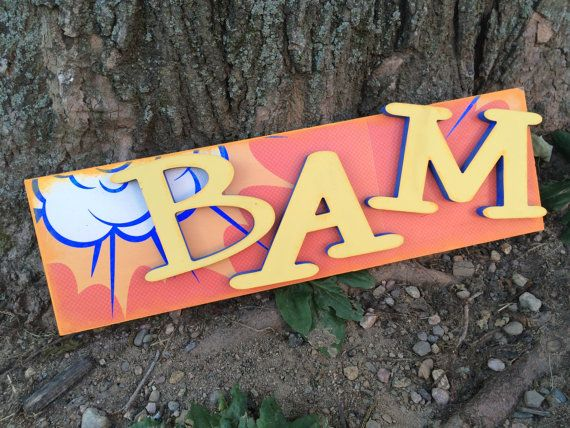 BAM! What a great addition to your little guys superhero decor! This is a custom hand painted BAM sign created with scrapbook paper, mdf letters and
