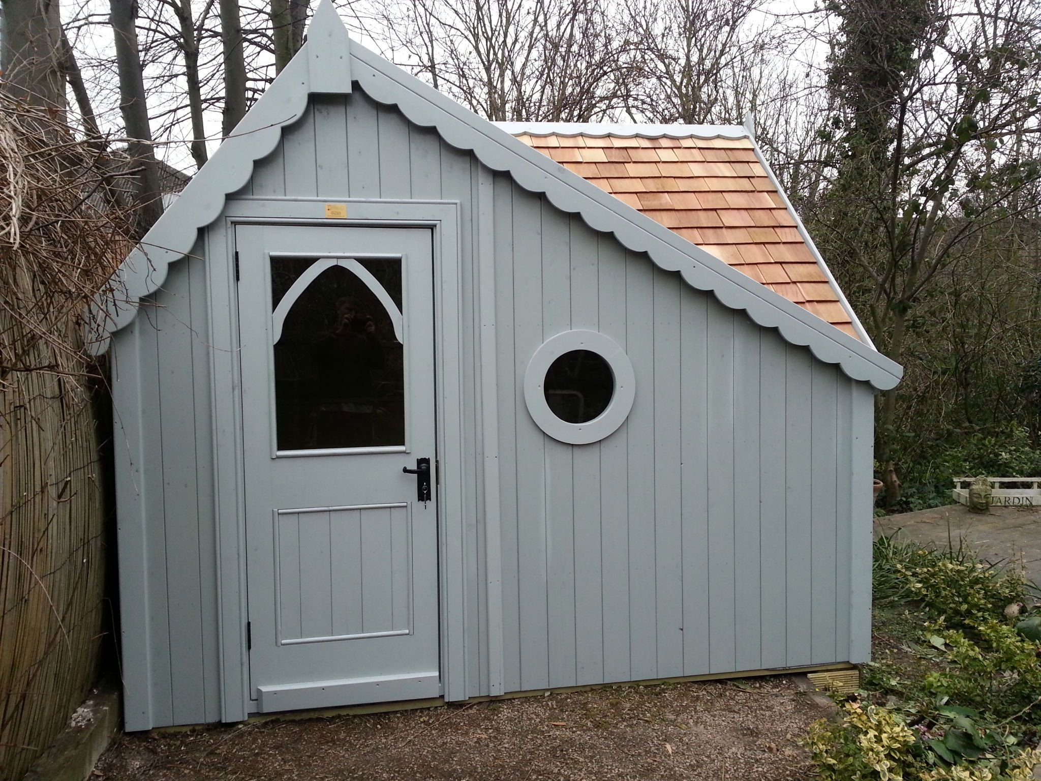 a super bespoke gothic shed installed this week cedar roof and painted chicago grey