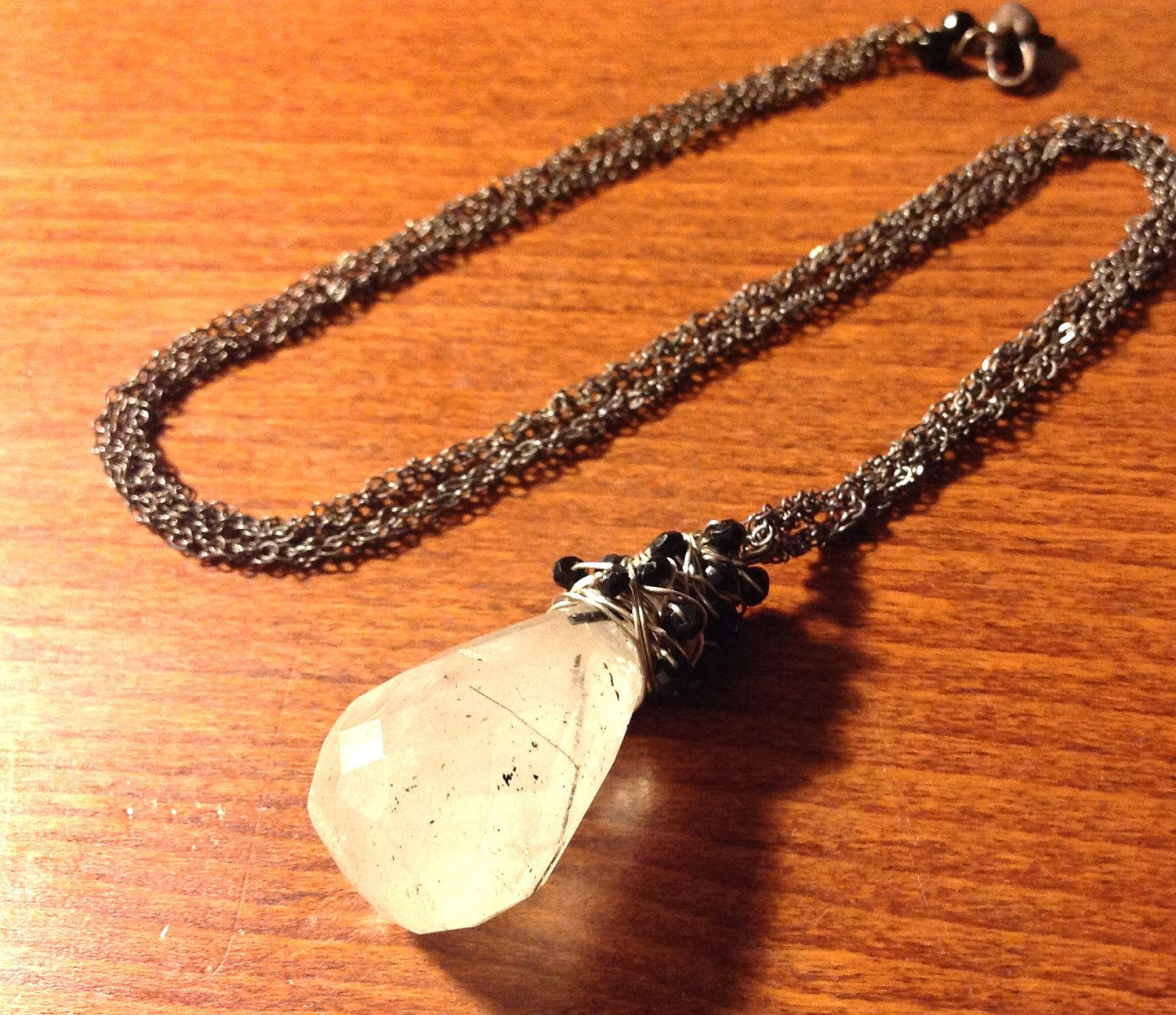 Tourmalated Quartz on Long Twisted Silver Chain with Black Tourmaline Accents. $130.00, via Etsy.