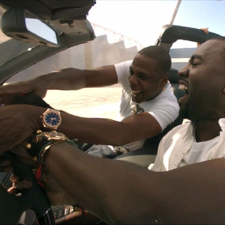 """Jay Z with Kanye wearing a Rose Gold Hublot in the """"Otis"""" music video."""