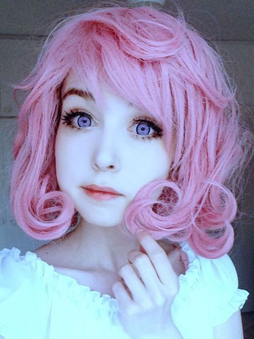 This girl looks like a doll or drawing. She's so perfectly ...