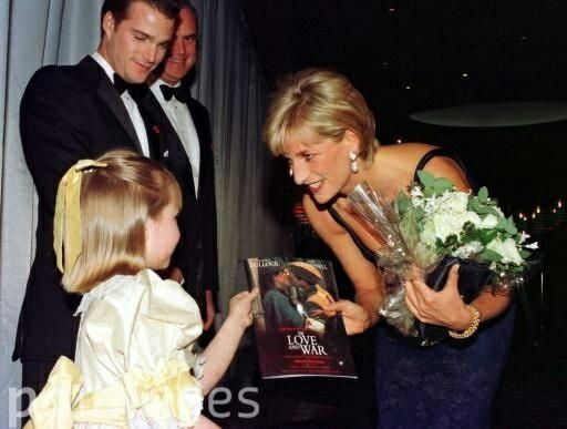 12 February 1997 Princess Diana meets Sir Richard Attenborough's granddaughter at the premiere of 'Love and War'.