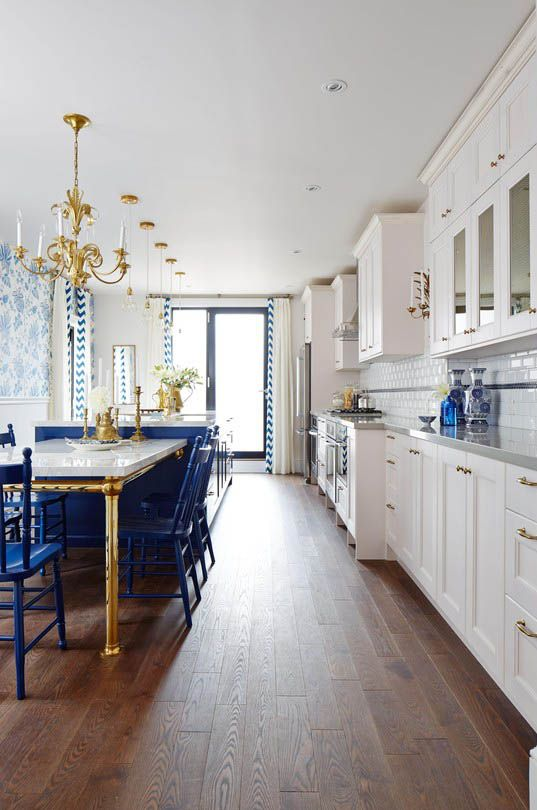 White, Royal Blue And Brass Kitchen With Dark Floors And A Great Layout For  Narrow Space   Sarah Richardson In Real Potential Via HGTV Canada
