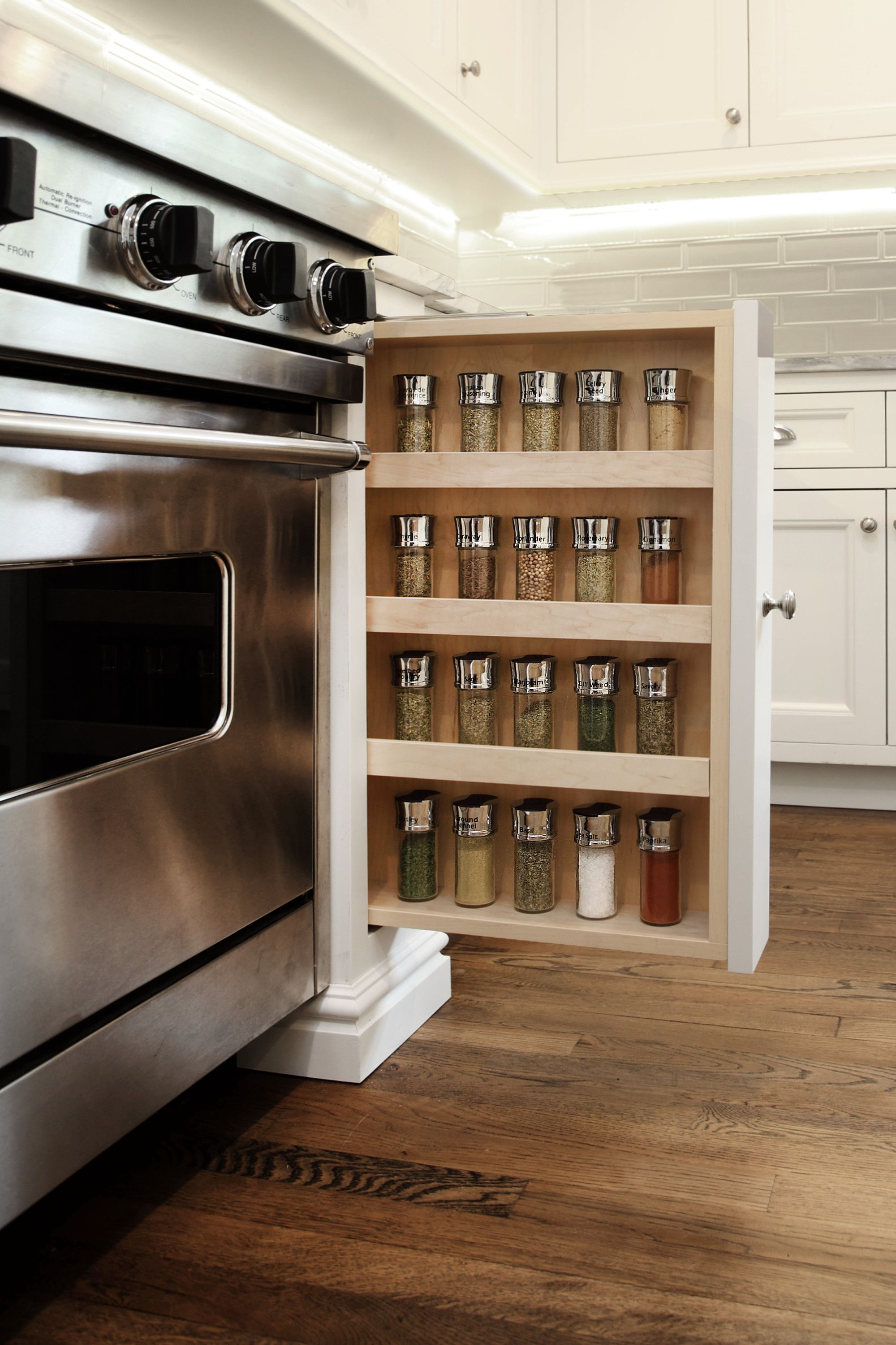 Built In Dedicated Spice Rack That Retracts Into Cabinet For Tidy