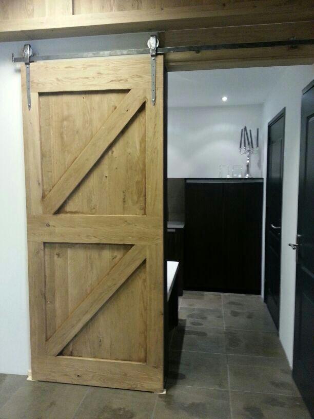 Handgemaakte eiken houten schuifdeur in de showroom van zusterbedrijf keukenhof van holten te - Haard thuis wereld ...