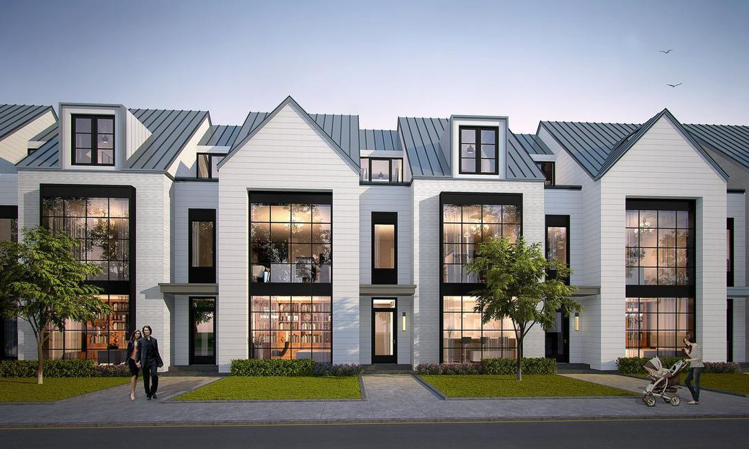 Pitched Roofs And Dormer Windows Lend A Cape Cod Esthetic To The