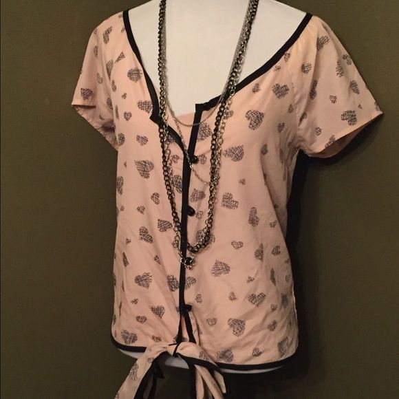 Small button down top with bow Baby pink and black small button down top. Size small. Also has fabric at the bottom to tie a bow. Small defect. The first button has no loop hole. Other than that flawless top Charlotte Russe Tops Button Down Shirts
