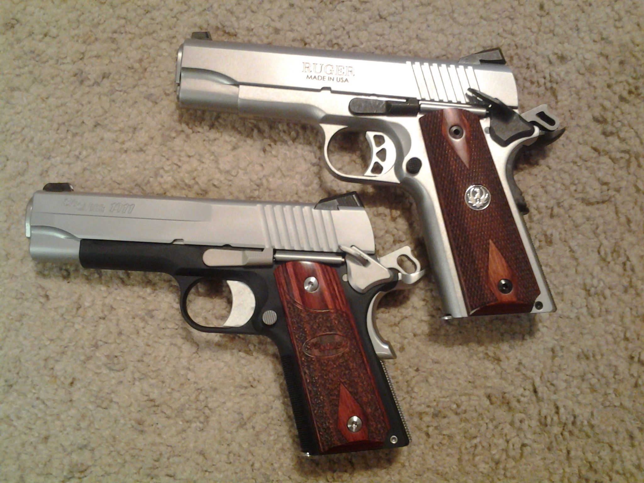 Sig and a Ruger 1911