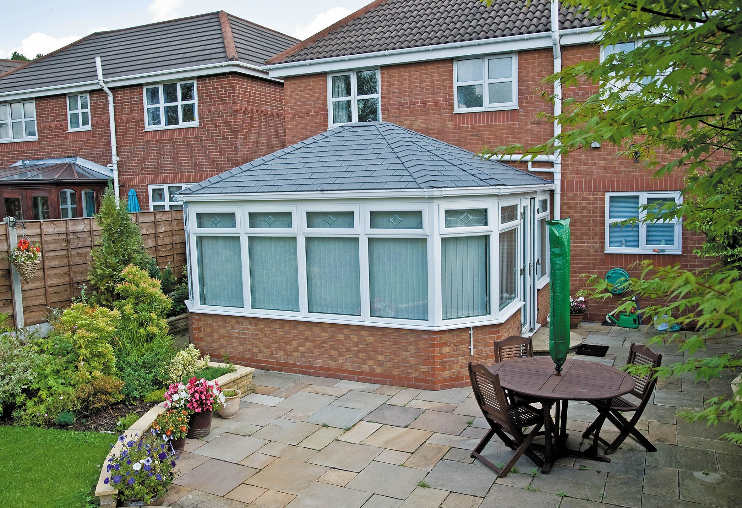 The Guardian Roof Looks Even Better When Contrasted To The Conservatory Next Door With An Inferior Polycarbonate Roof