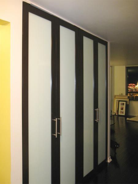 Modern Glass Closet Doors To These Ones Are Stunning With The Milk Glass Finish Nice Handles Chocolate Brown Metal Check Out Cat Coming Around Corner Eyes Shining Modern Glass Closet Doors For Your Home Closets Pinterest