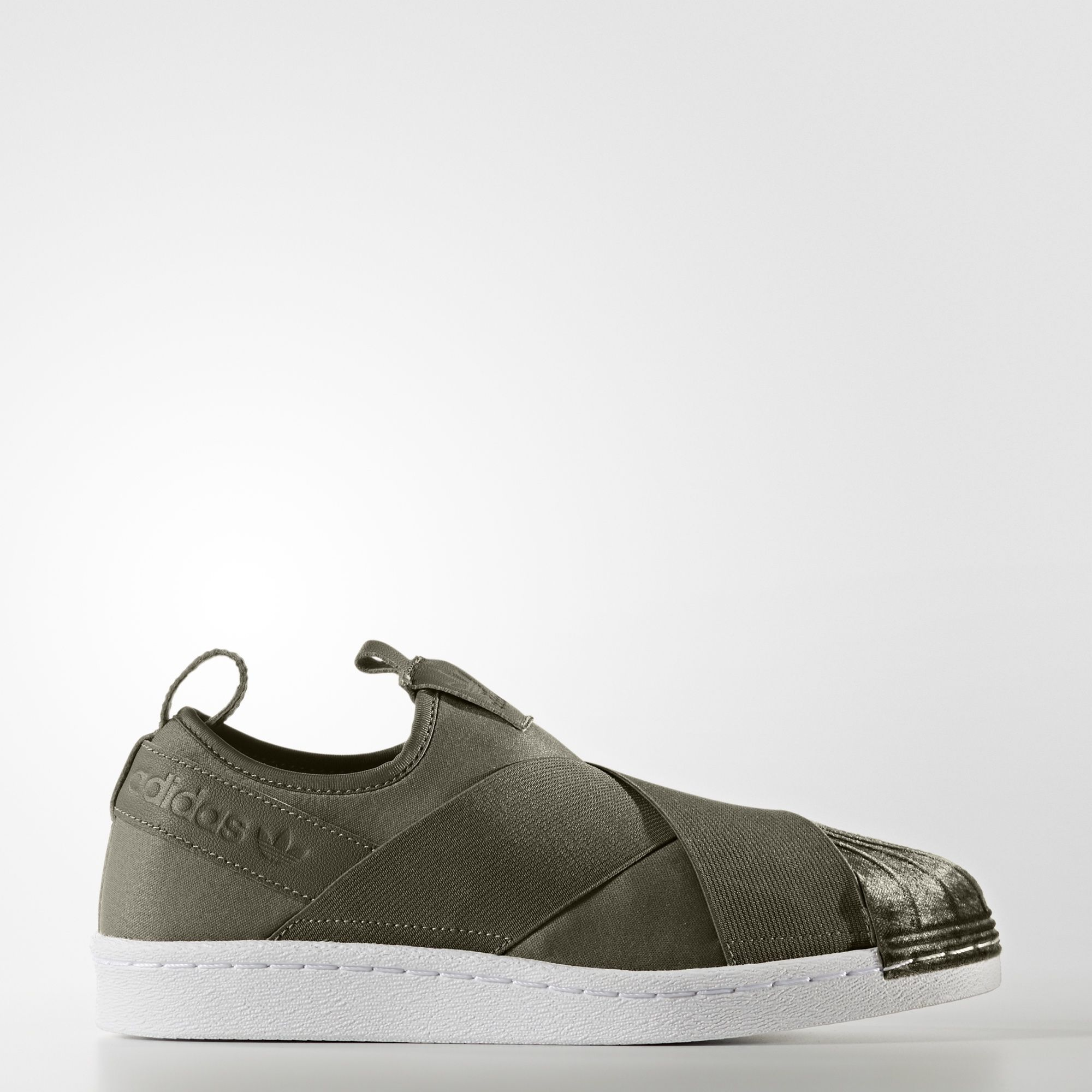 official photos a6ac3 857ad The famous adidas Superstar shoes show off a softer side. These women s  shoes go cozy with muted, autumn tones, a comfy slip-on fit, a luxe velvet  shell toe ...