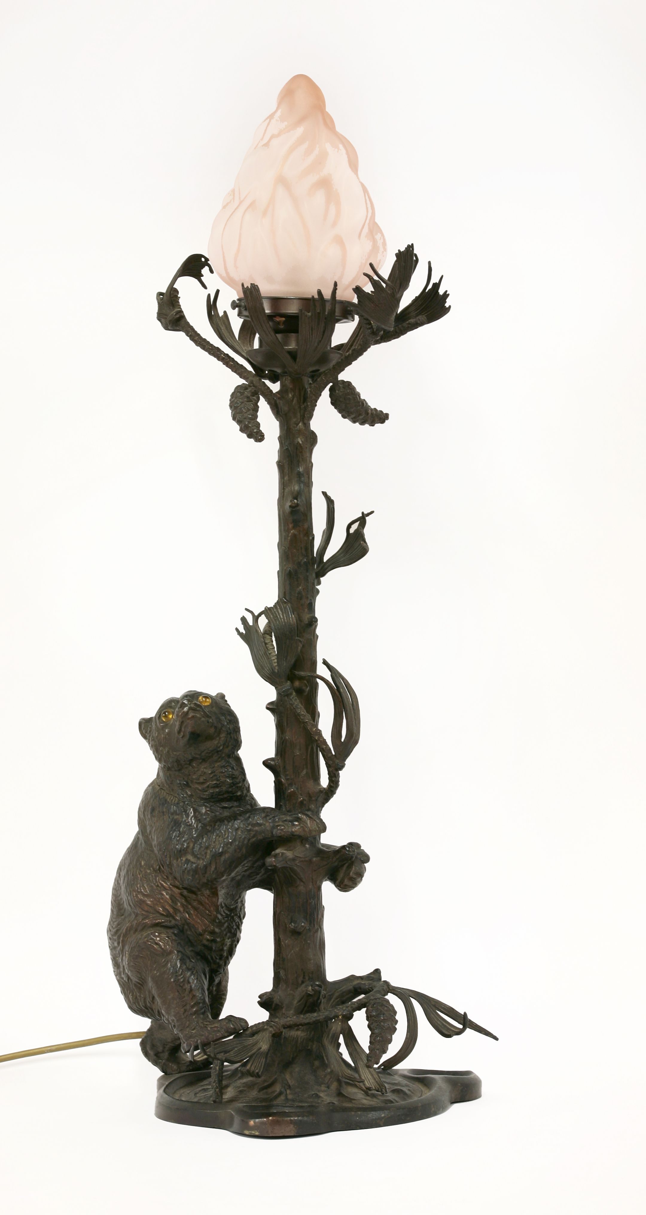 A patinated table lamp, bronze, modelled as a bear attempting to ascend a tree, the bear with glass eyes which illuminate, 76cm high, including shade Est £300-500 4th March 2014