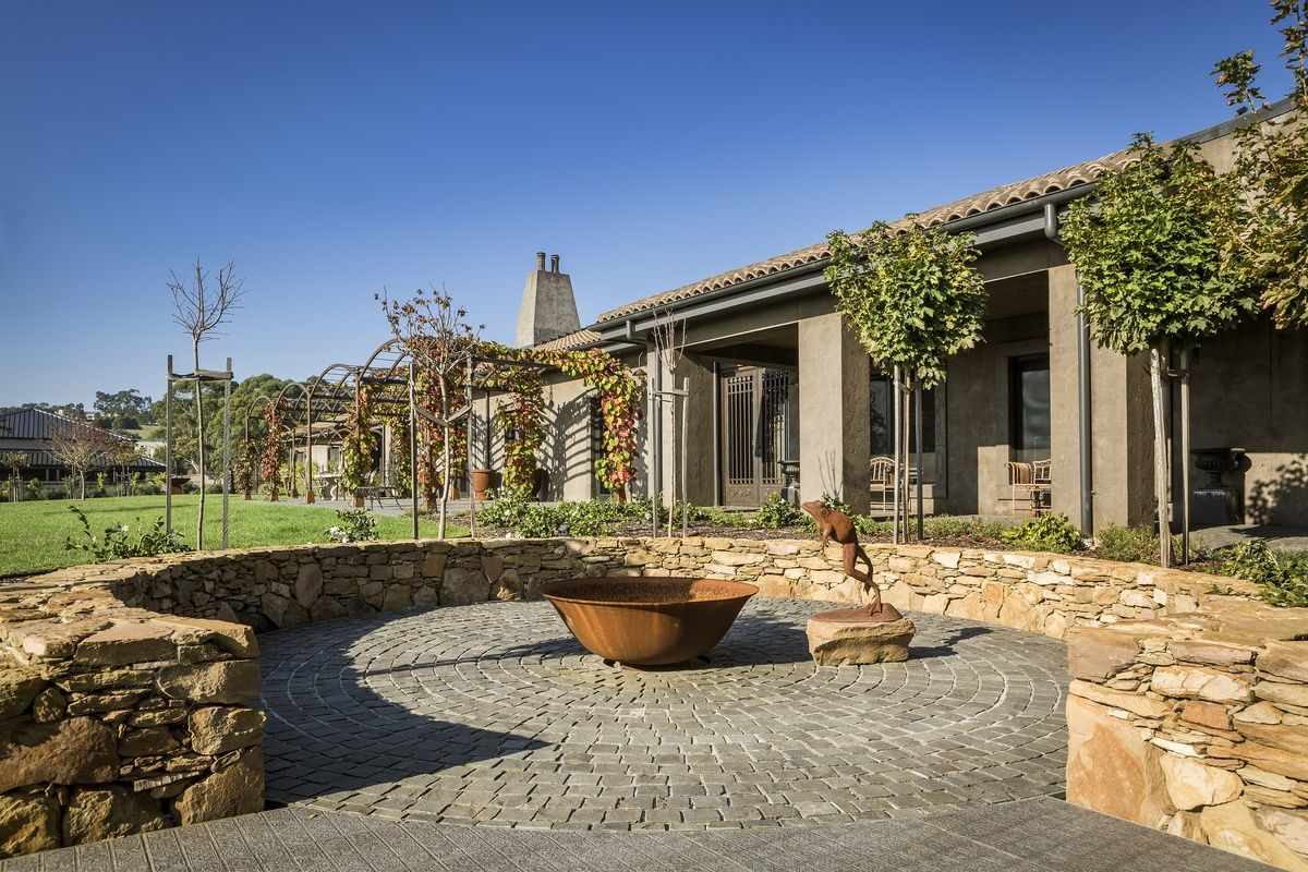 Luxury Stone Exterior french provincial home featuring luxurious stone works on the