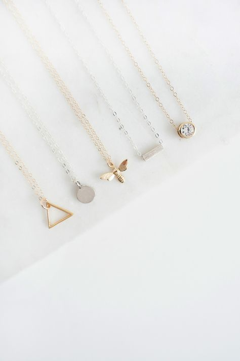 A minimal jewellery collection featuring minimalist necklaces, earrings, rings, bracelets & more. Handmade in the UK.