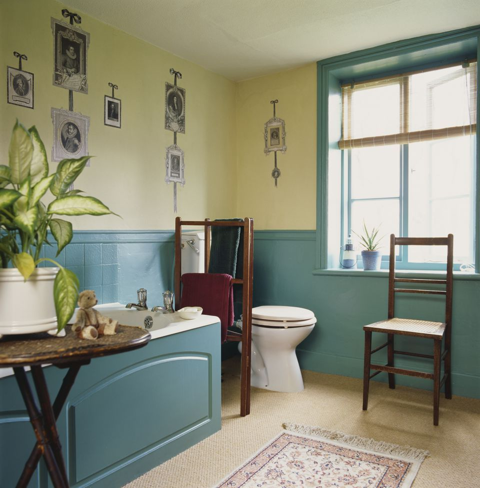 Traditional bathroom with wooden tub enclosure whitewainscoting