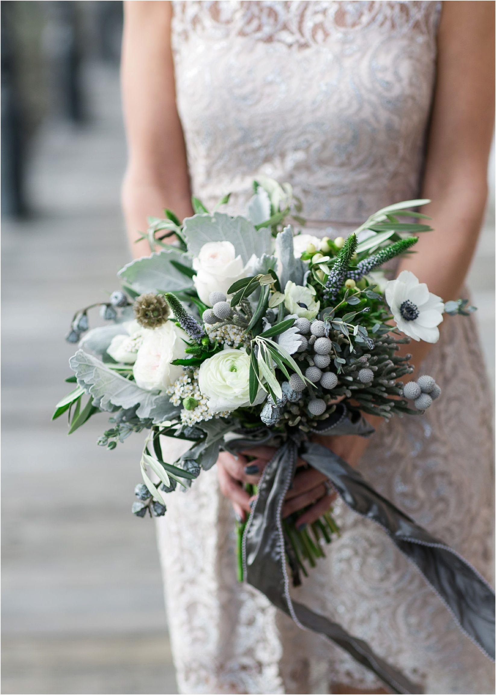 green and blow bridal flowers The Big Fake Wedding | The Rice Mill Charleston SC Wedding - Anchor & Veil Photography | Charlotte, NC Wedding Photographers