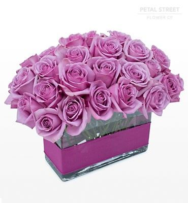 Bold And Sophisticated Four Dozen Purple Roses Arranged In A
