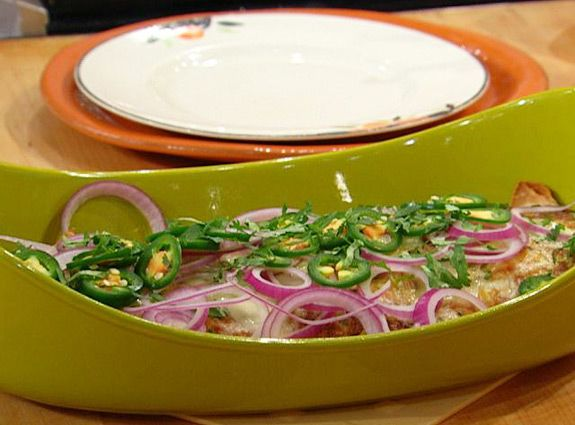 Cheese and Green Chile Enchiladas - Rachel Ray Show.  It would be good with cooked chicken added to the filling.