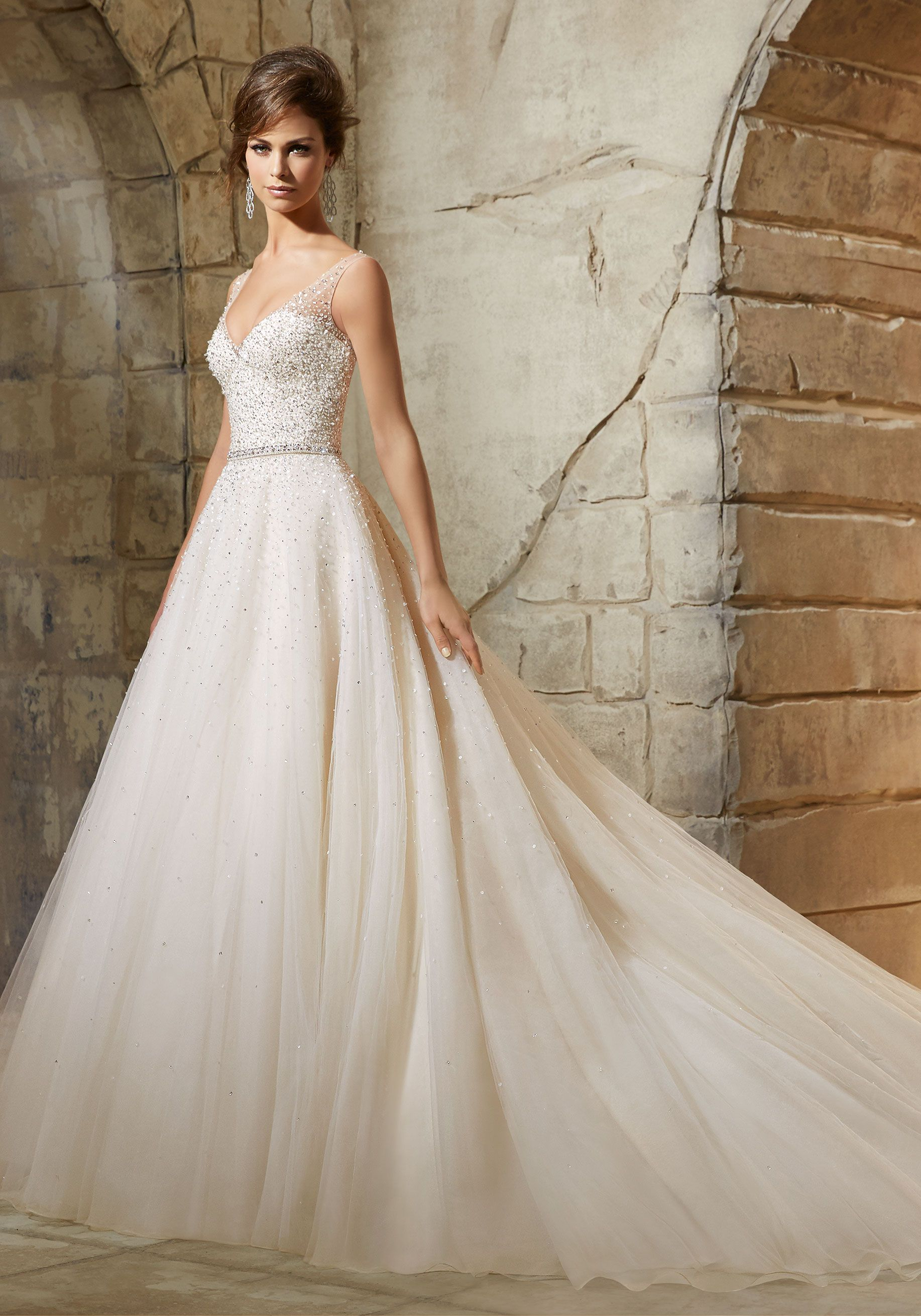 Aline bridal dress with crystal beading and sheer vneckline and
