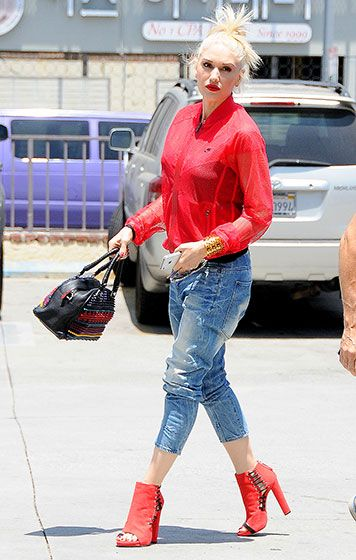 0cb34d2de50 Gwen Stefani was red-hot in a mesh track jacket and open-toed booties while  out and about in L.A. That bag is amazing!