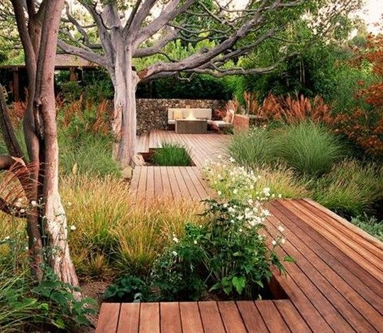 Rob Steiner Gardens.Very much the idea for the backyard: decks and walkways moving you through the planting areas and no grass to mow! Plus, very easy to accomplish in stages.