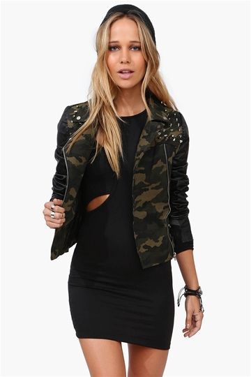959da5fa38928 A camouflage print with faux leather sleeves, with fun silver stud  embellishment on shoulders. Pair with tight black dress and clunky boots.