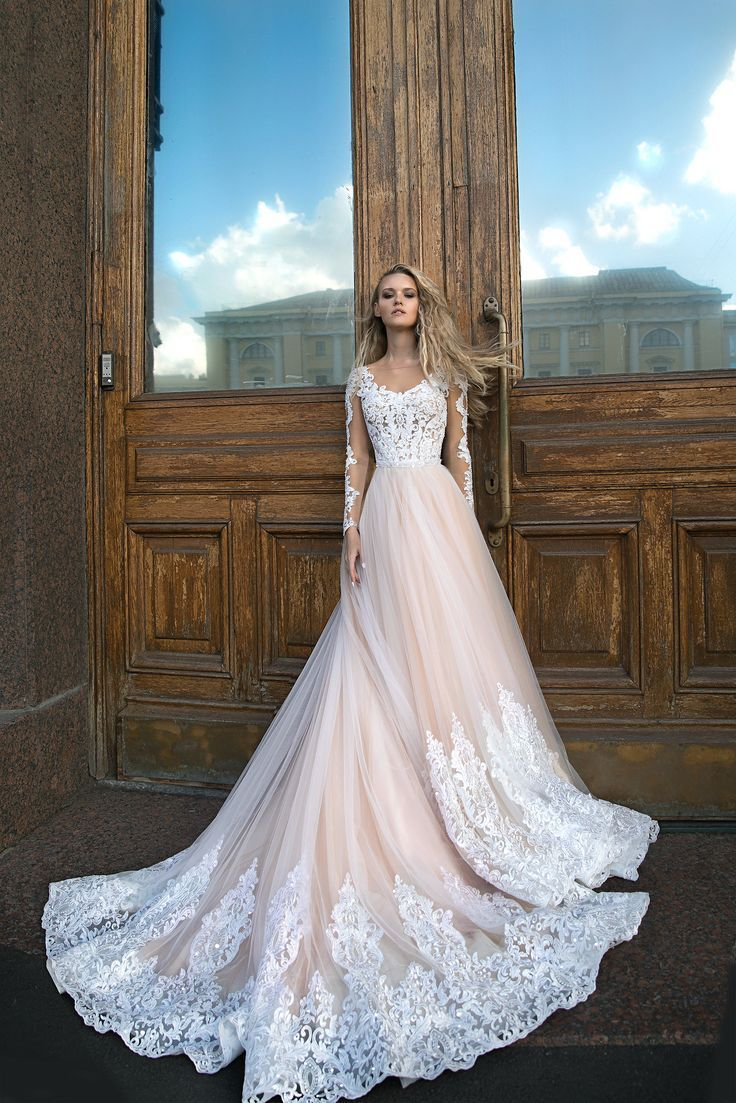 A Silhouette wedding dress Greyst by Olivia Bottega, long sleeves wedding dress, lace on the bottom of skirt wedding dress