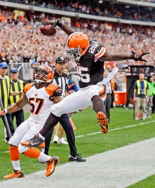 Browns running back Chris Ogbonnaya goes airborne after a one-yard touchdown catch against Bengals. Linebacker Vincent Rey isn't as happy. (Tony Dejak/AP)  More Browns 17, Bengals 6