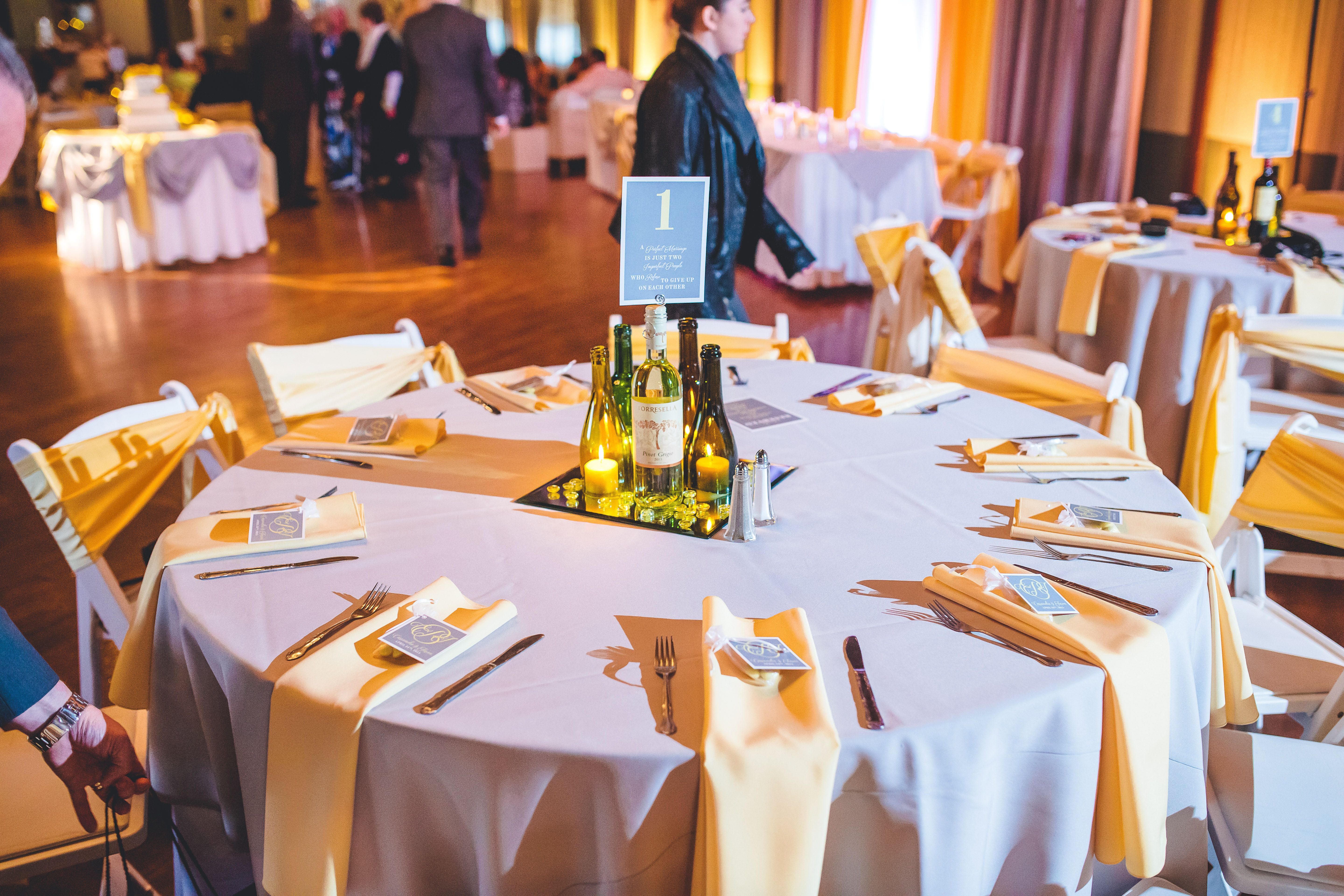 Gray and yellow wedding table setting with DIY Wine bottle centerpieces candles decorative stones & Gray and yellow wedding table setting with DIY Wine bottle ...