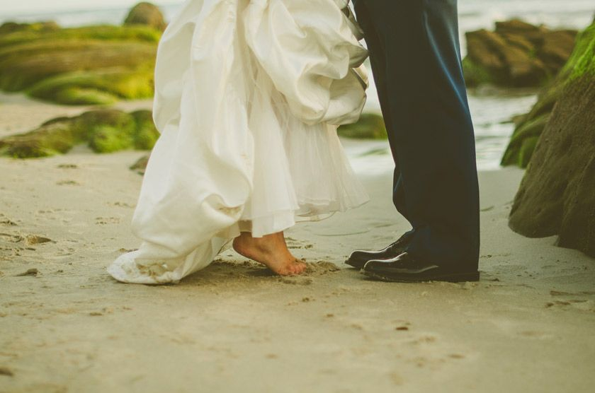 san diego beach wedding: bride and groom feet on toes in the sand
