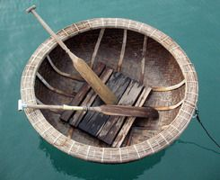 This is a coracle a small round boat used on rivers in for Round fishing boat