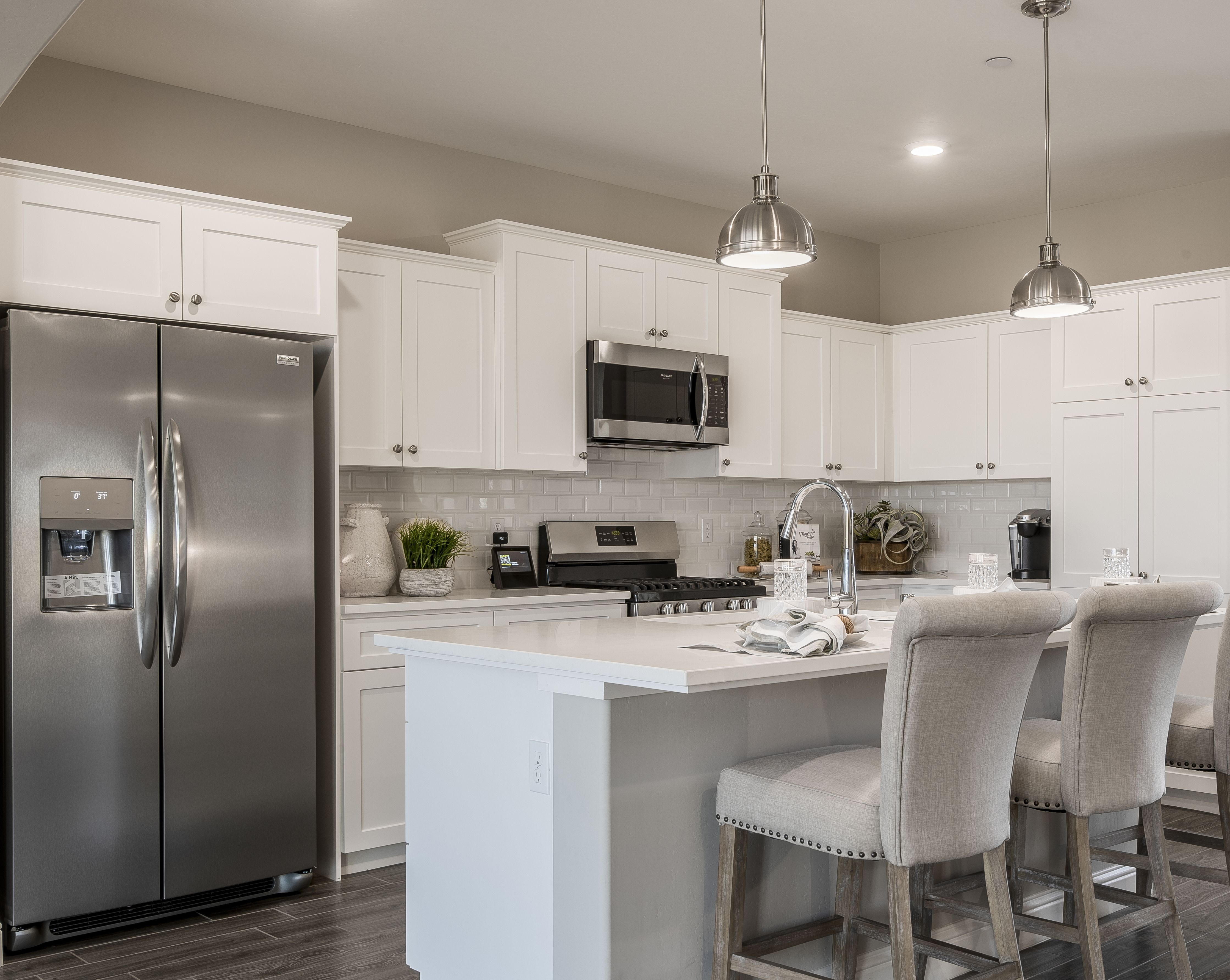 All White Kitchen With Classic Subway Tiles Kitchen Island With Breakfast Bar New Kitchen Cabinets California Homes New Home Construction