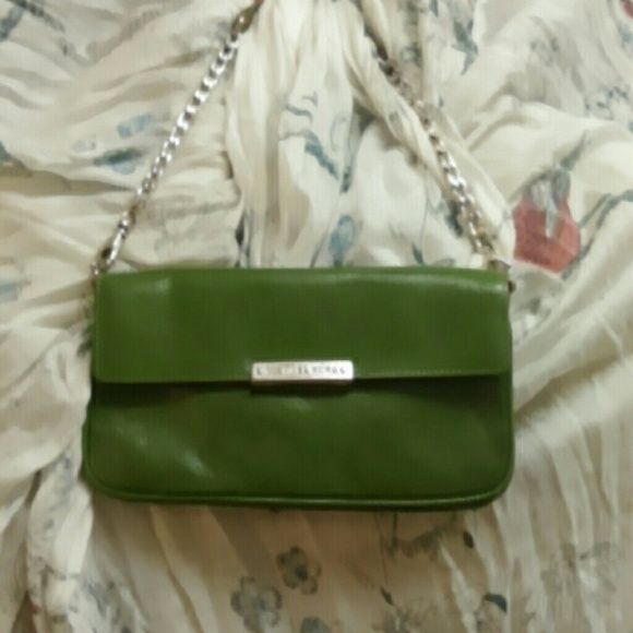 Authentic Michael Kors handbag Leather vintage like bag, it was my starter bag into the Michael Kors brand! The silver on the nameplate has chipped, but is still legible. The leather and interior are in perfect condition. Michael Kors Bags Clutches & Wristlets