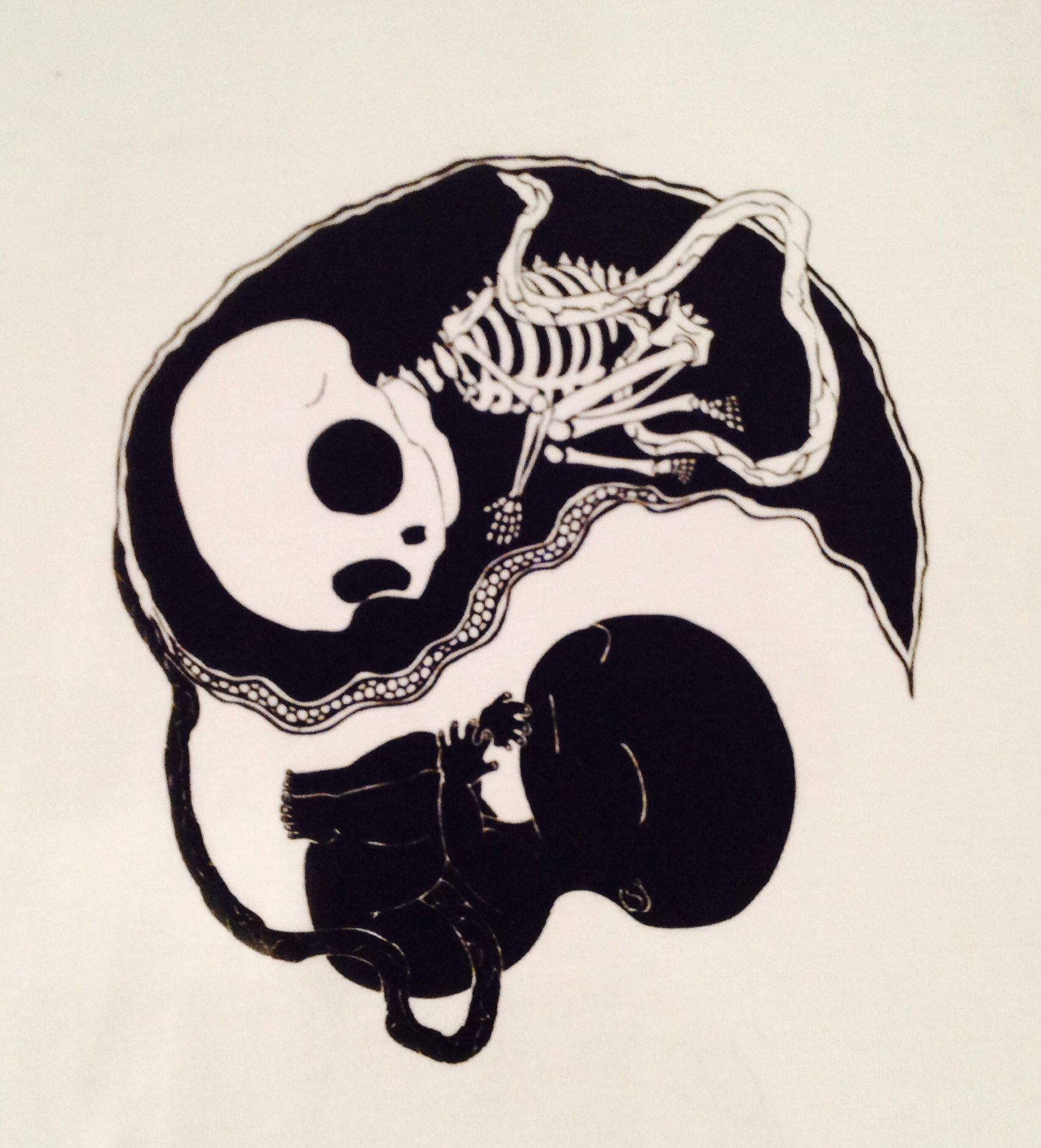 The yin and yang of life in this 'Embryo' design by Alan Chu is printed on black or white t-shirts of various women's sizes