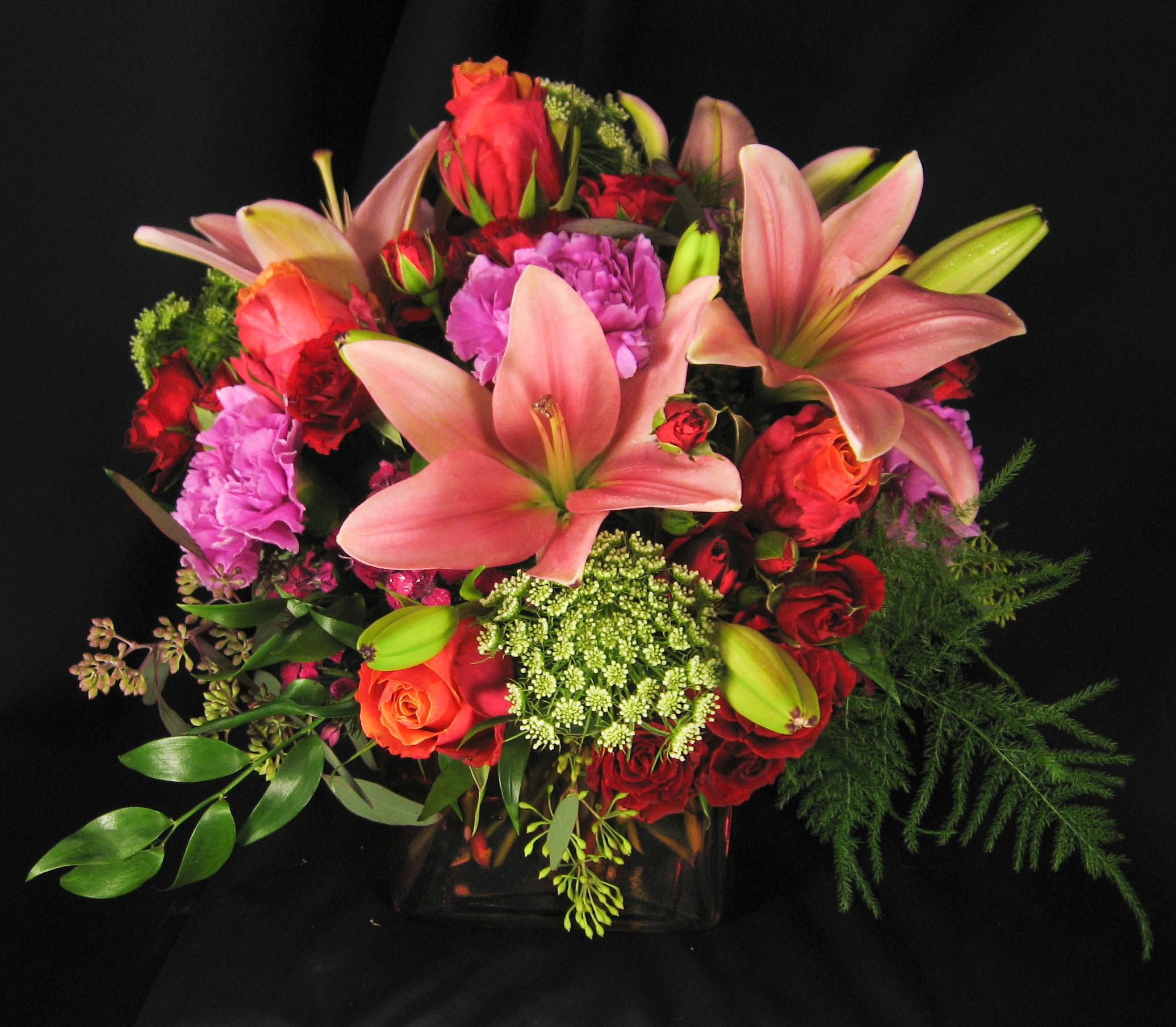Coral, Pink And Green Centerpiece For Wedding In A Clear